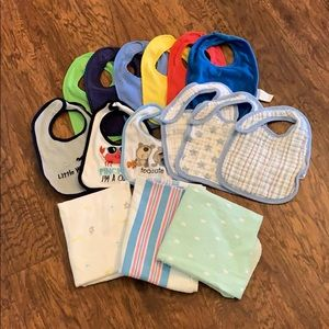 Lot of bibs and receiving blankets.